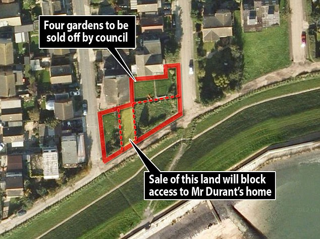 Up for auction: This aerial shot shows the land the council is selling, including the strip which provides access to Mr Durant's home