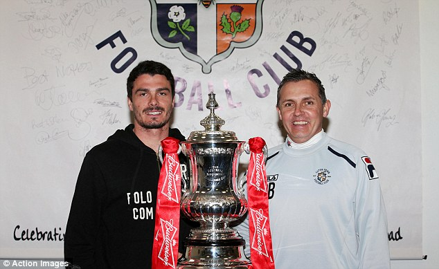 Up for the cup: Luton skipper Ronnie Henry and manager Paul Buckle pose with the trophy