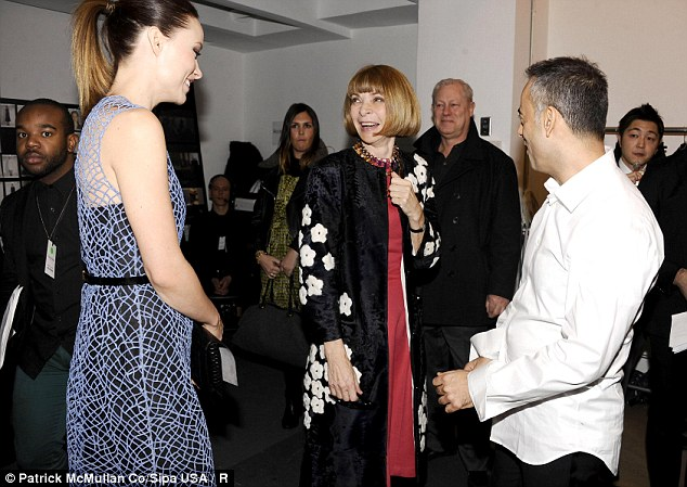 Power chat: Olivia and Anna Wintour gabbed backstage with Calvin Klein designer Francisco Costa