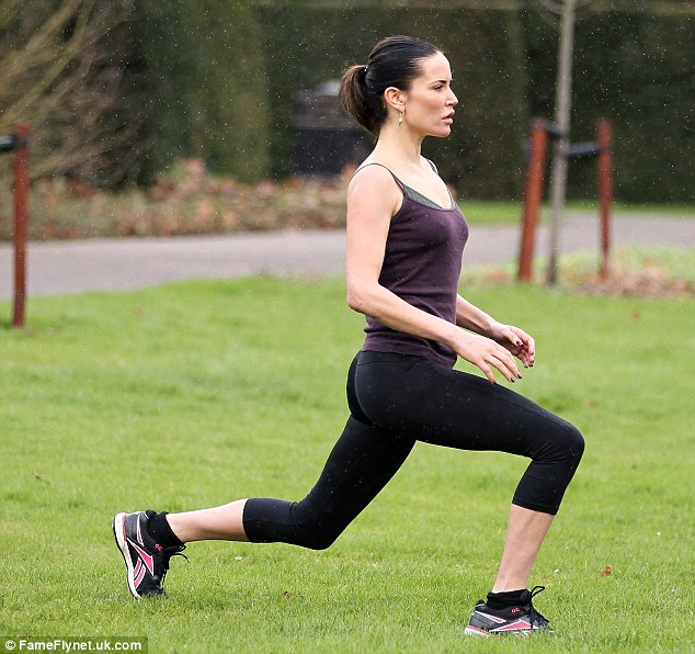 Hard work: The model had to take part in a 8 hour a day fitness programme including circuit training and hiking