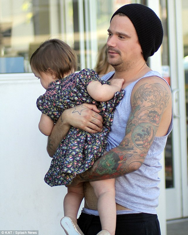 Doting uncle: The 32-year-old wore a beanie hat for the casual outing