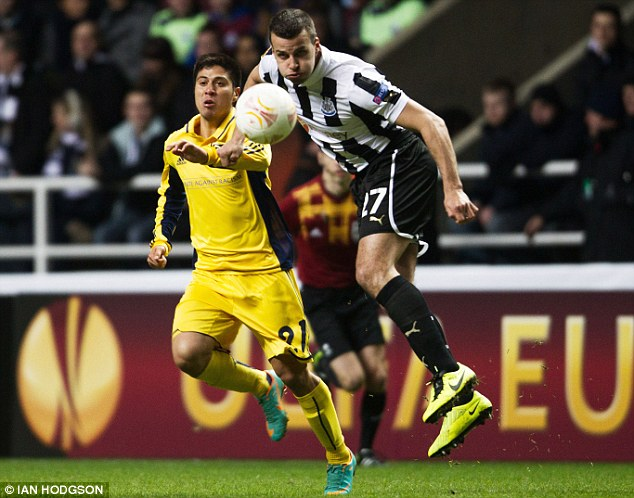 In action: Taylor battles during Newcastle's Europa League tie against Metalist