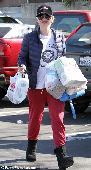 Not for date night: Anna Faris wore a much more casual red-themed look in Studio City, California