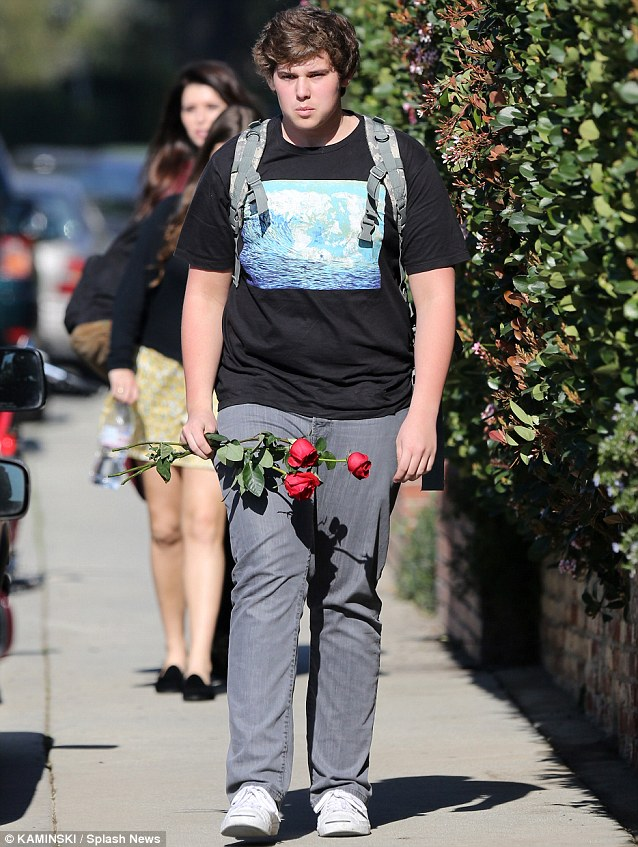 Love is all around: Arnold Schwarzenegger's kids gather at a family friends house for Valentines Day with Christopher carrying roses