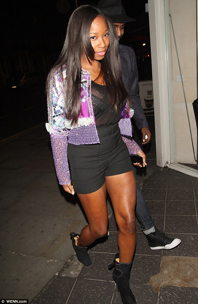 Attracting attention: Jamelia certainly didn't do much to blend in, pairing the revealing outfit with a garish purple jacket