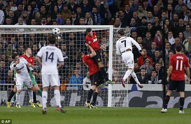 One giant leap: De Gea was beaten by an unstoppable Cristiano Ronaldo header at the Santiago Bernabeu