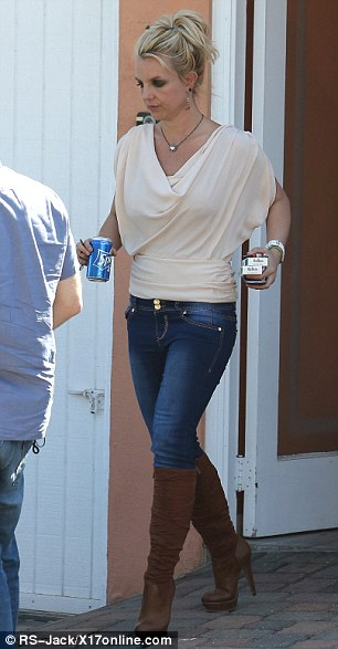Looking just peachy: Earlier on Thursday, Britney was spotted shopping in Malibu