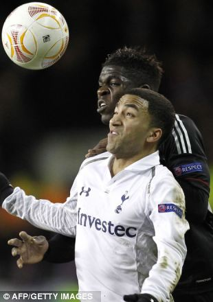 Tough test: The score leaves the tie finely balanced, with Tottenham's Aaron Lennon challenging Lyon's scorer Umtiti