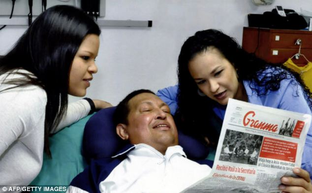 Chavez was also pictured looking at the Cuba Communist Party newspaper Granma, in a shot said to have been taken yesterday
