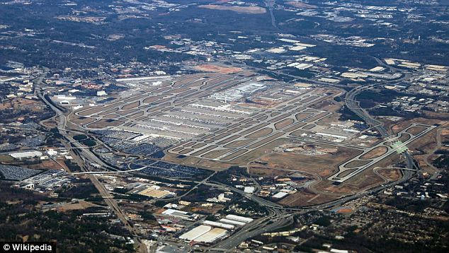 Final approach: The aircraft was about to land at Atlanta airport, pictured, when the child started to cry