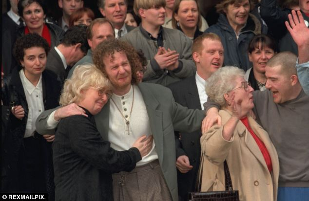 Hickey celebrates with his mother, cousin Michael and aunt Ann Whelan after his release