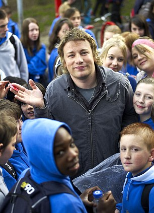 Speaks volumes: When Jamie Oliver launched his campaign to improve school dinners, mothers were pictured shovelling crisps and takeaway burgers to their kids through the playground railings