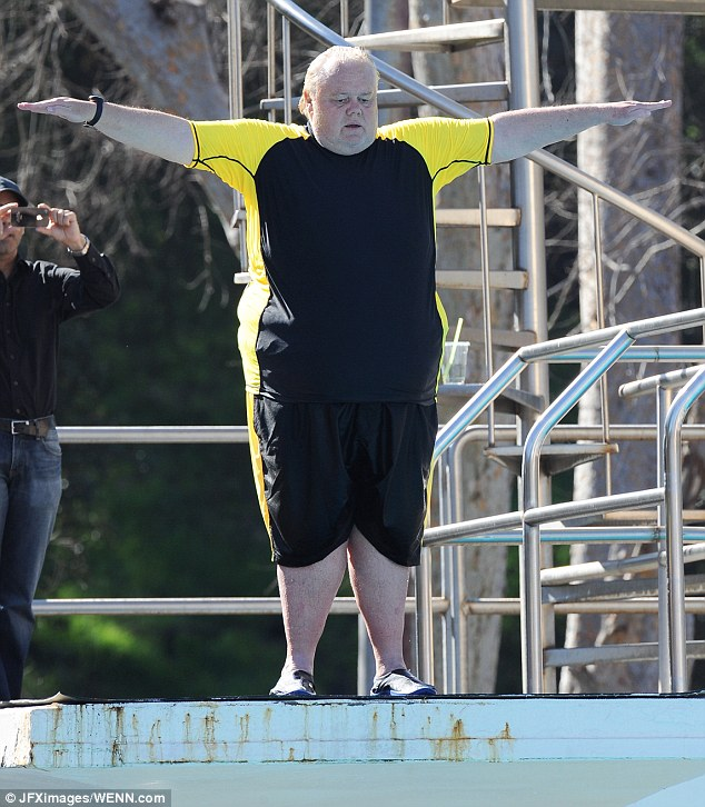 On your mark: The funny man tries not to look down from the competition height platform