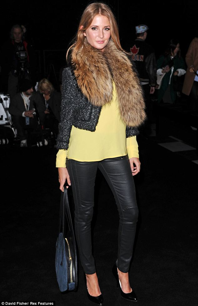 Fashion fan: Millie Mackintosh looked lovely in leather trousers with a bright yellow jumper