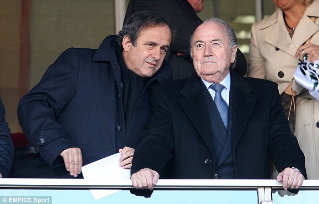 Act now: UEFA president Michel Platini (left) and FIFA counterpart Sepp Blatter must curb the power of agents