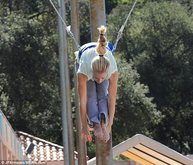 Weee! The former girlfriend of Hugh Hefner did her best to bring out her inner gymnast