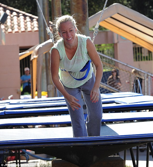 Bouncing babe: Former Playboy playmate Kendra Wilson seemed to be struggling on the wired trampoline