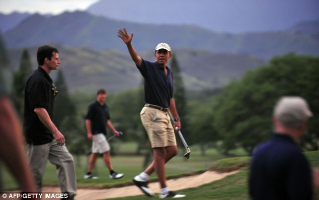 No photos: Though he has been pictured on other trips- like this one in Hawaii in 2009- the President denied any press access during his round of golf with Tiger Woods over the weekend
