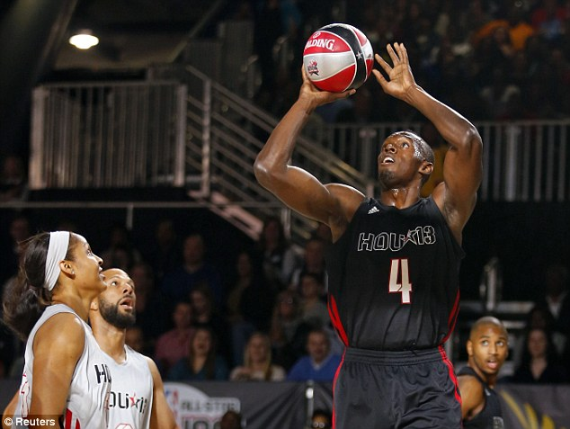Man of many skills: Jamaican sprint king Usain Bolt shoots during the NBA All-Star celebrity game in Houston
