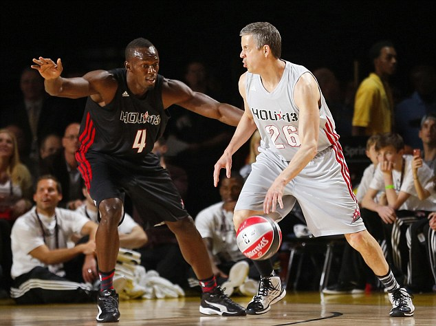 On the defence: Bolt guards U.S. Secretary of Education Arne Duncan