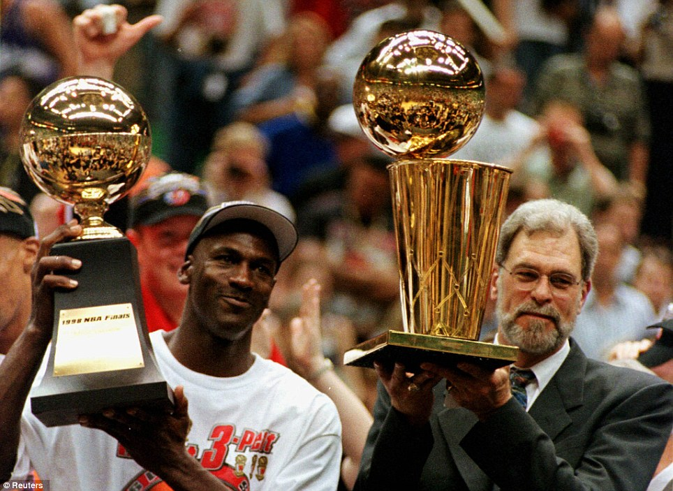 Born winner: Jordan and Bulls coach Phil Jackson hold their MVP and NBA championship trophies after beating Utah Jazz to the NBA championship in 1998