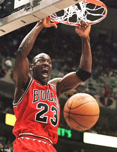 Ruthless: Jordan celebrates as he slam-dunks the ball in a match in Salt Lake City in 1998