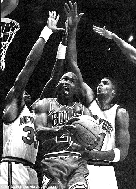 Sandwiched: In this archive image, Jordan is sandwiched by two opponents from the New York Knicks