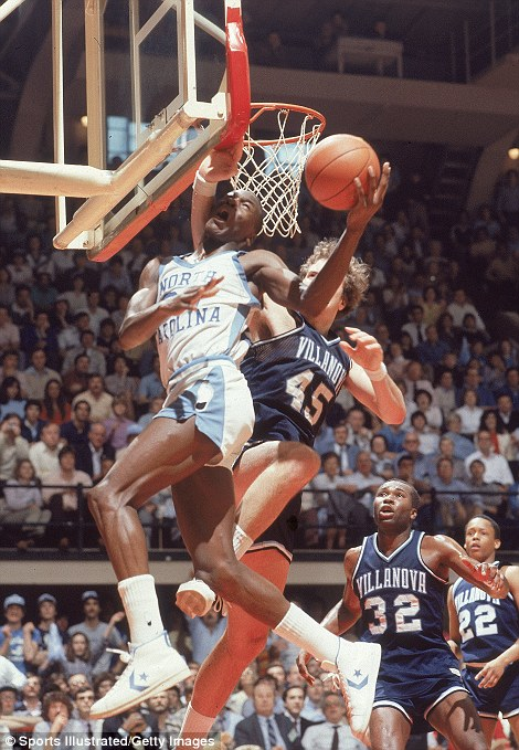 Early promise: Jordan shows his ability to slam dunk in this 1982 match for the university against Villanova