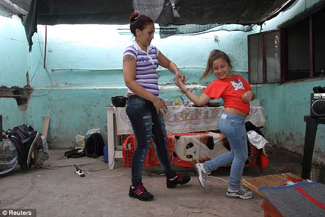 Love: Prisoner Silvia Rodas, left, dances with her daughter Anahi, 9, during a visit by Anahi to the prison where Rodas is serving a 15-year sentence for robbery and attempted homicide