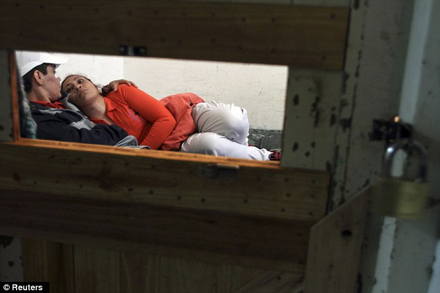 Companionship: Silvia Rodas, 25, right, lies in bed with her girlfriend Yesica in their shared cell in Bahia Blanca, 350 miles south of the capital Buenos Aires