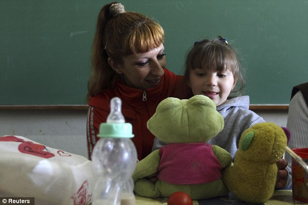 Strange existence: Valeria Cigara, 28, left, who is currently in prison awaiting trial for robbery, plays with her four-year-old daughter Milagros in Magdalena, August 19, 2012