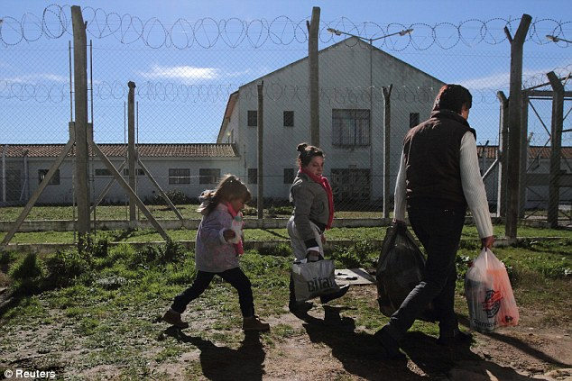 Visiting time: Four-year-old Milagros, left, her aunt Jorgelina, center, and her grandmother Silvia, right, arrive to visit Milagros' mother, Valeria Cigara, at a prison in Magdalena, August 19, 2012
