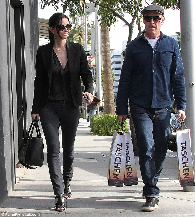 A new Friend? Friends star Courteney Cox was spotted going on a shopping spree with a mystery man on Friday in Beverly Hills