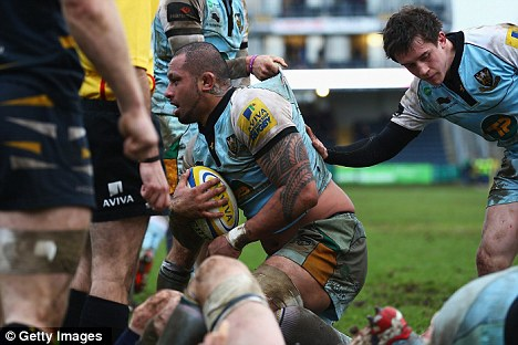 Muddy marvel: Samu Manoa scores the decisive try