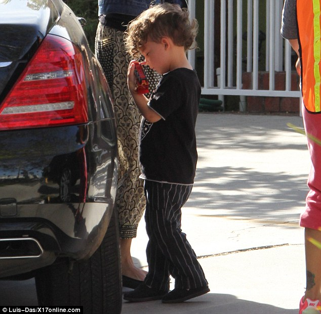 Hair raising: The three-year-old has had his locks cut into a mohawk