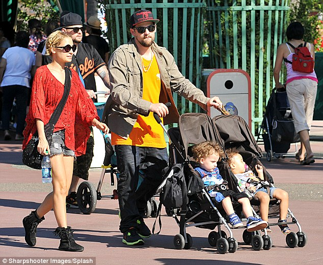 Two is enough: The designer said for now she and Joel, pictured at Disneyland when the children were younger, are not planning to have another baby