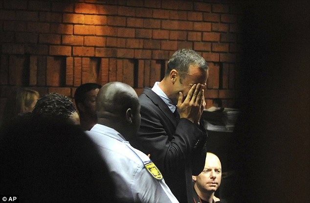 Shock: Pistorius appears in court charged with premeditated murder, but says he killed his girlfriend accidentally after mistaking her for an intruder at his home