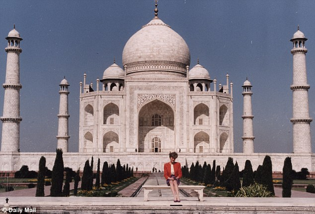 Diana in front of the Taj Mahal, during a Royal tour of India in 1992. Ms Paglia has compared the iconic image of Diana looking lonely and wistful, with shot of Rihanna on her balcony in Barbados