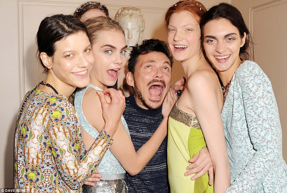 Model love: An ecstatic Matthew Williamson embraces his models backstage at his London Fashion Week Fall/Winter 2013/14 show at the Royal Opera House today