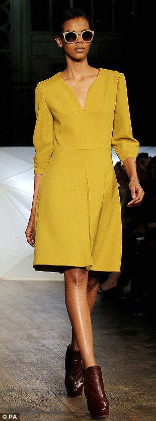 The reverse teardrop neckline and sulphur yellow colour featured heavily