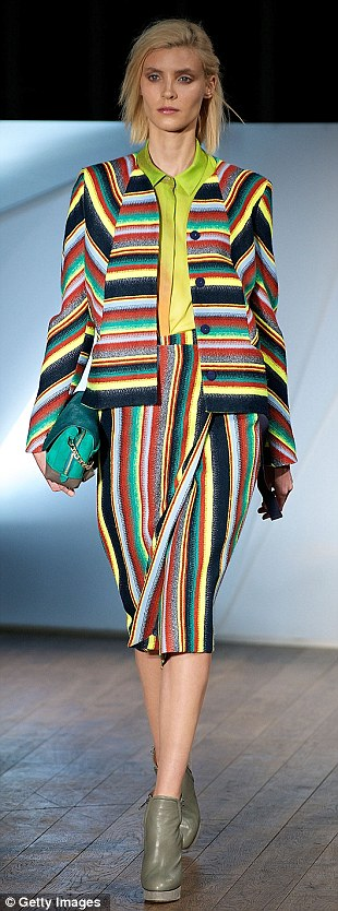Stripes fantastic: Felt-type skirt suit in stripes that echo Paul Smith, paired with matching clutch