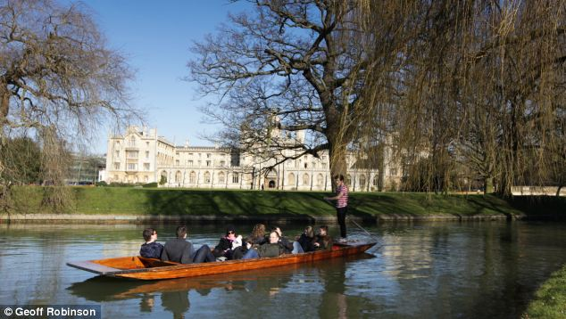 Sunny: Punters enjoy the sun on the River Cam in Cambridgeshire today