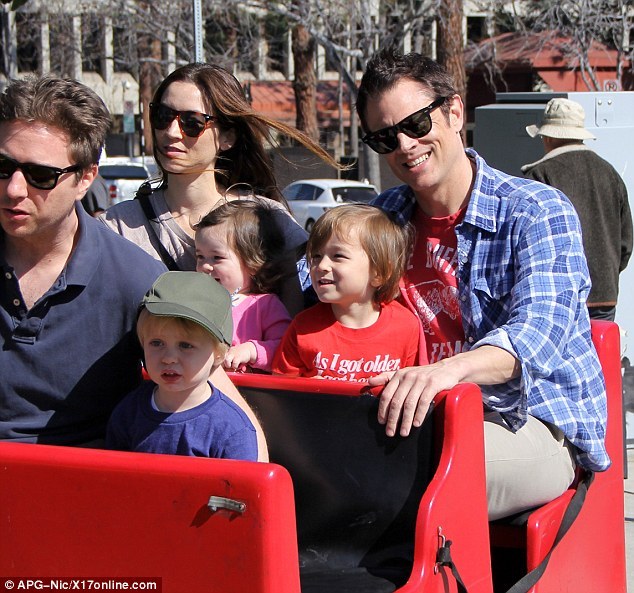 Gentle ride: Stuntman Johnny Knoxville took his wife Naomi Nelson, their son Rocko and daughter Arlo, to the Farmer's Market on Sunday in Los Angeles