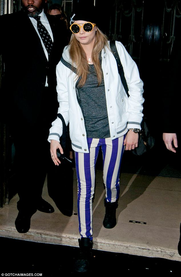 Model of the Year: Cara (pictured leaving the Mulberry show) won the award at the British Fashion Awards, then came the famous Burberry campaign in which she appeared with the young Romeo Beckham