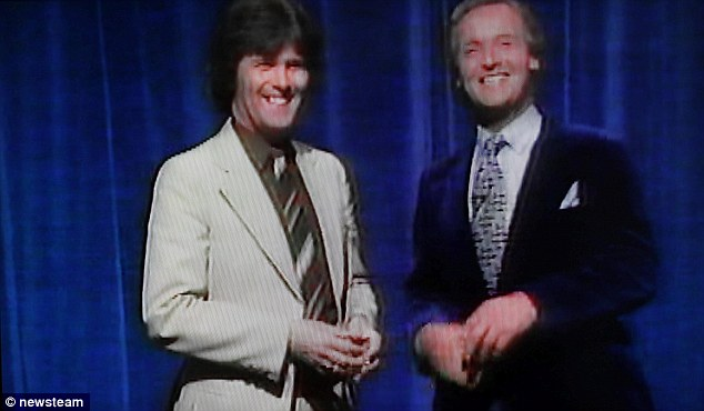 Trivia-mad: David in his first television appearance with presenter Nicholas Parsons on Sale of the Century in 1982