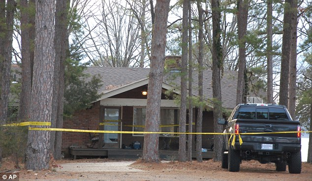 Yellow crime-scene tape blocks off the home of Mindy McCready in Heber Springs, Arkansas on Monday, February 18, 2013, the day after the country singer was found dead there Sunday in an apparent suicide