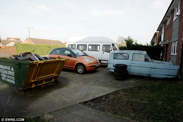 What a state: Miss Frost's current home in Gloucestershire is blighted by a bashed-up minibus, car and a skip