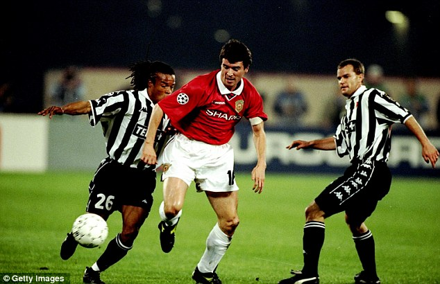 Leader: Roy Keane earns his place at the centre of midfield