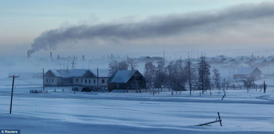 Nomadic no more: Smoke rises from houses as residents try to keep warm in the depths of winter where, in the 1920s and 1930s, it was a stopover for reindeer herders until the Soviet government made the site permanent in efforts to settle nomadic people