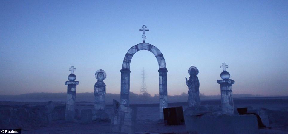 Ice maiden: Ice sculptures on the Lena river, created for the Orthodox Epiphany celebration in the valley where daily living problems include pen ink freezing, glasses freezing to people's faces and batteries losing power
